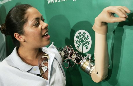 "WASHINGTON - SEPTEMBER 14:  Claudia Mitchell demonstrates the functionality of her ""bionic arm"" during a news conference on September 14, 2006 in Washington, DC. Mitchell is the first female recipient of a ""thought controlled bionic arm"", an advanced prosthesis, developed by the Rehabilitation Institute of Chicago.  (Photo by Win McNamee/Getty Images)"
